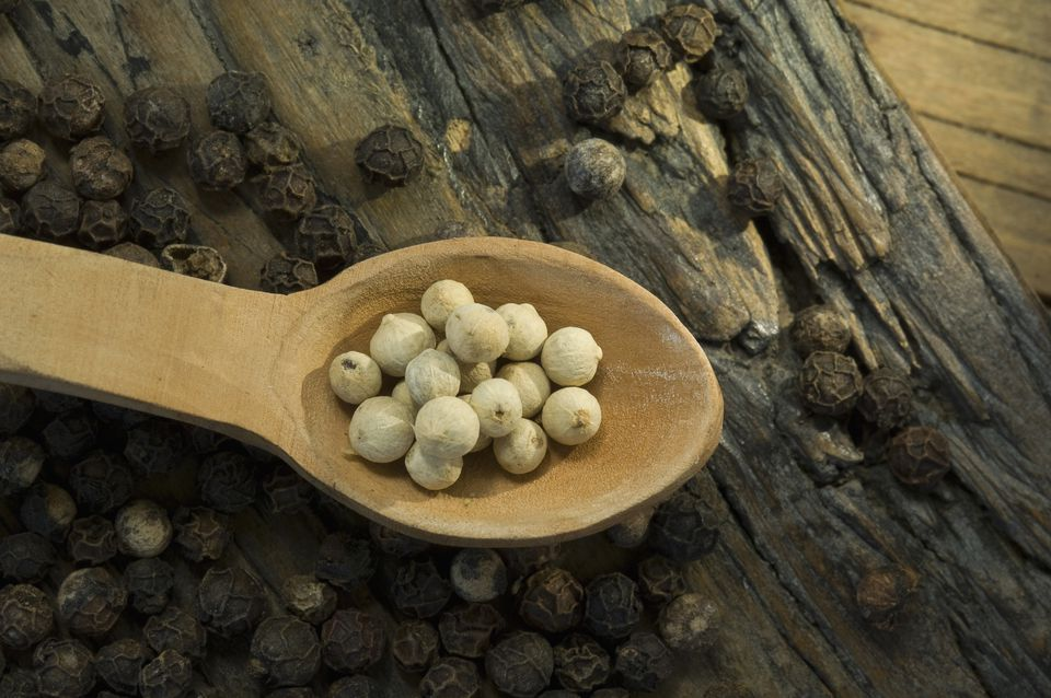 White and black peppercorns
