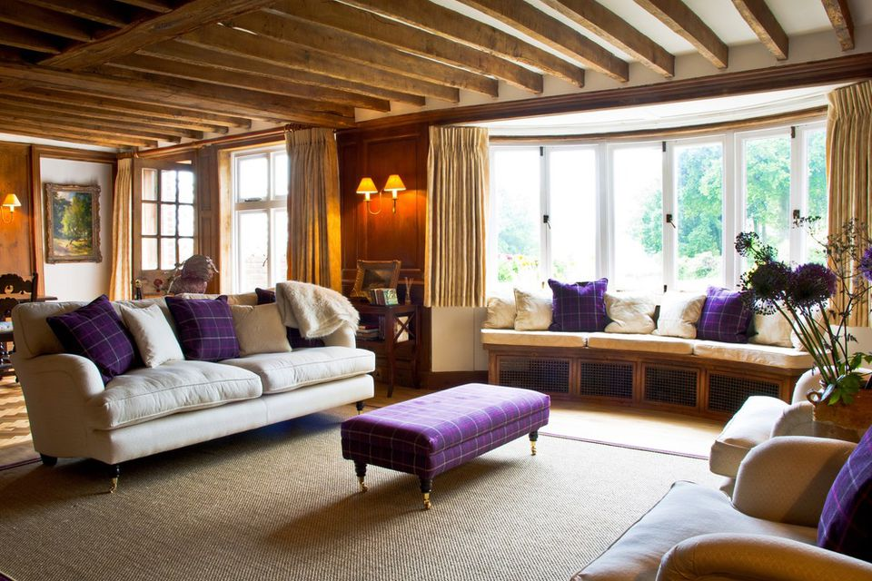 pops of violet plaid in living room