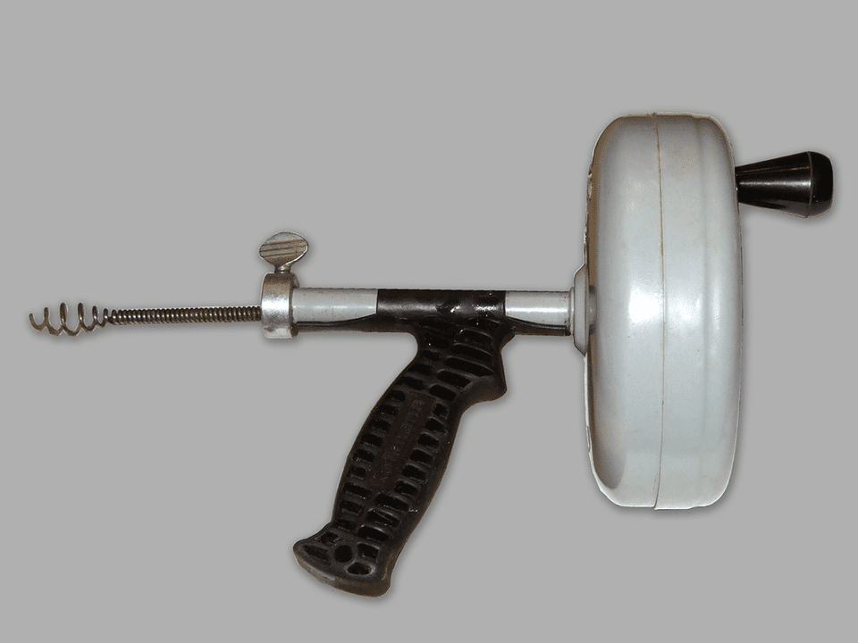 A handheld drain auger