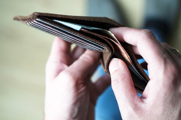Cropped Image Of Hand Removing Money From Wallet