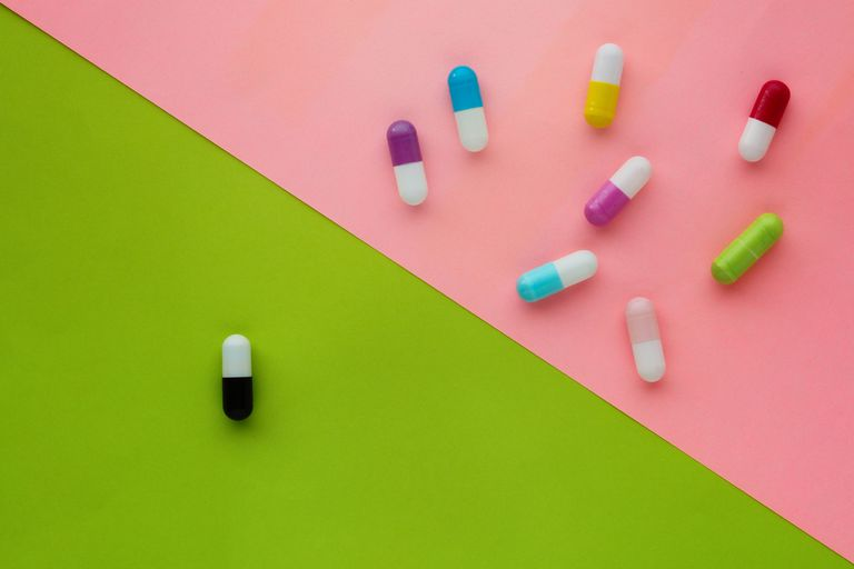 Pills on colored backgrounds