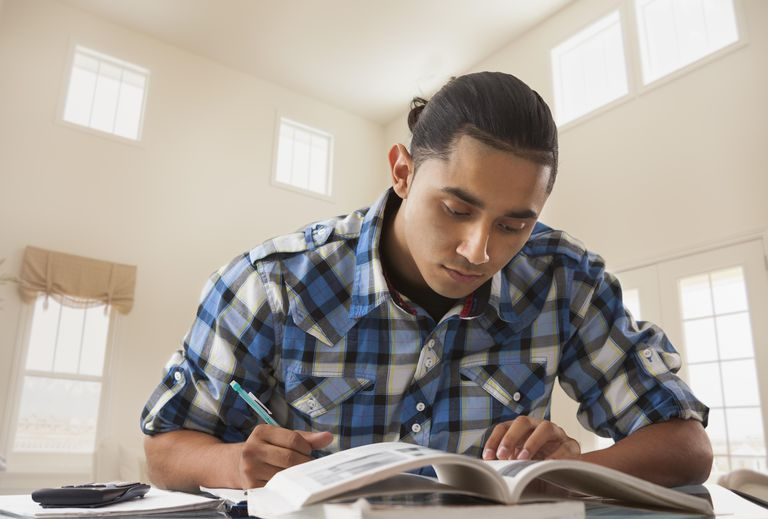 Hispanic man studying at desk