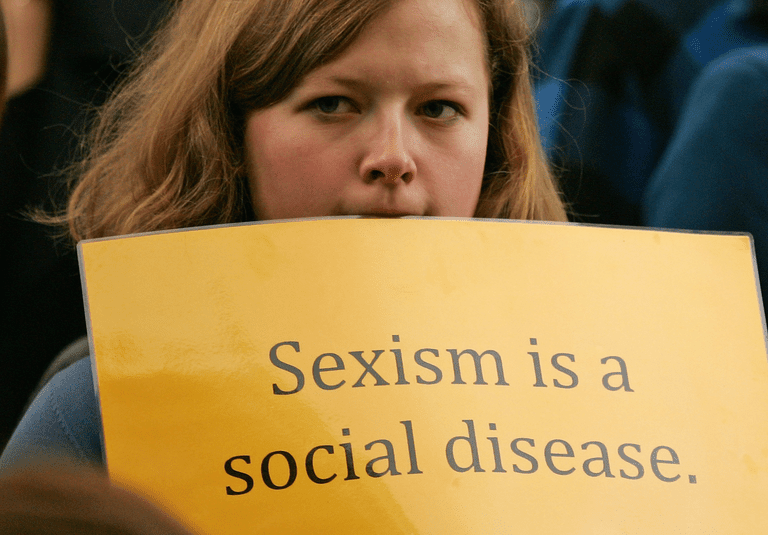 """Sign says """"sexism is a social disease"""""""