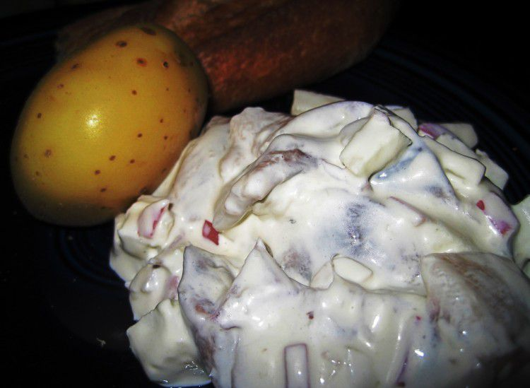 Renate's Herring Salad in Northern German Style with a yellow potato