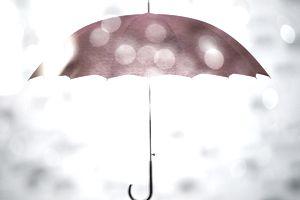 Red umbrella through raindrops