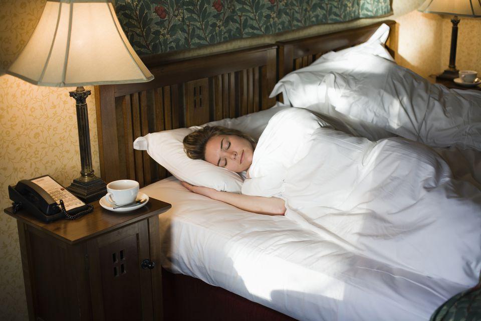 Woman sleeping in hotel room