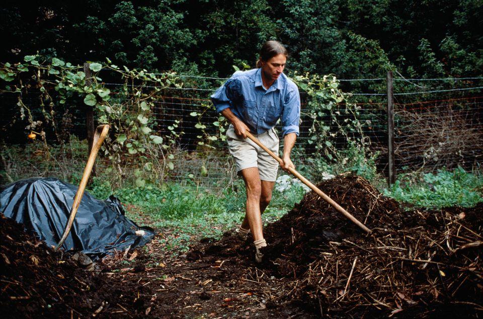 Man Shoveling Mulch