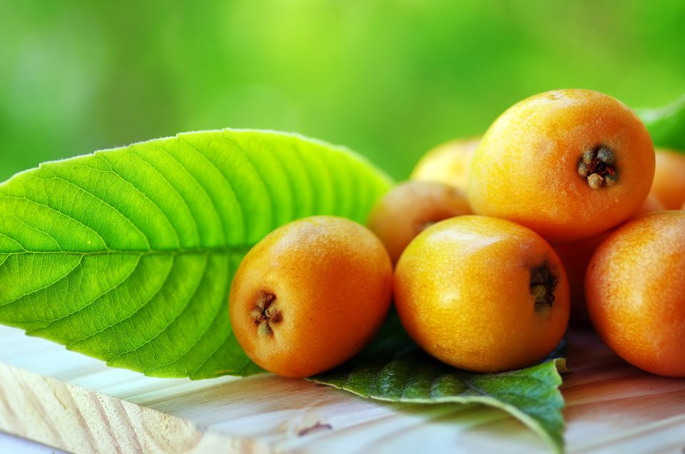 Loquats On Wooden Table