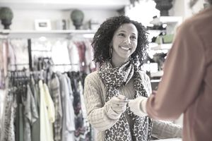 Woman paying for items at store
