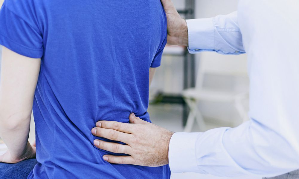 Doctor examining back