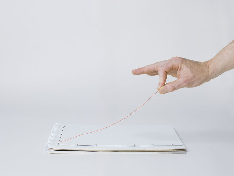 Hand elevating graph line off the page
