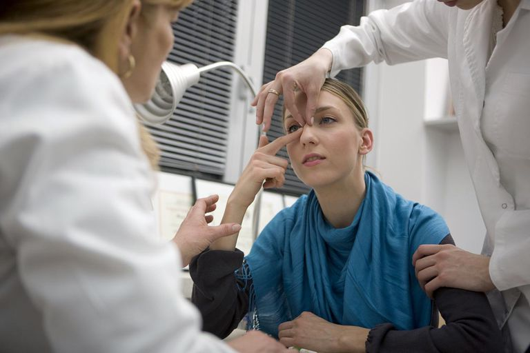 female patient getting a nose exam
