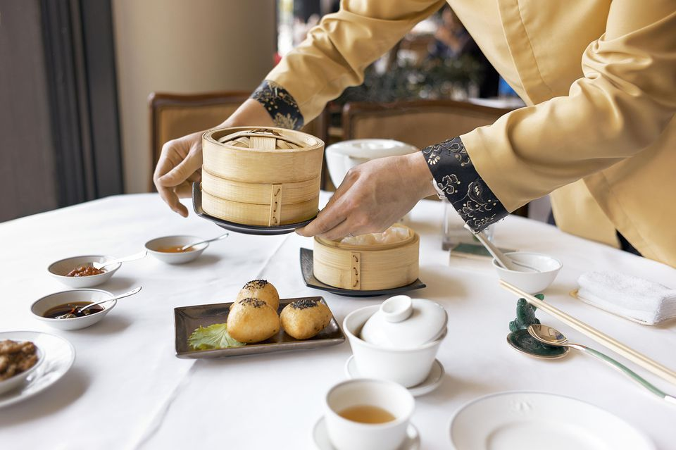 A set table with tea and dim sum dishes in Hong Kong.