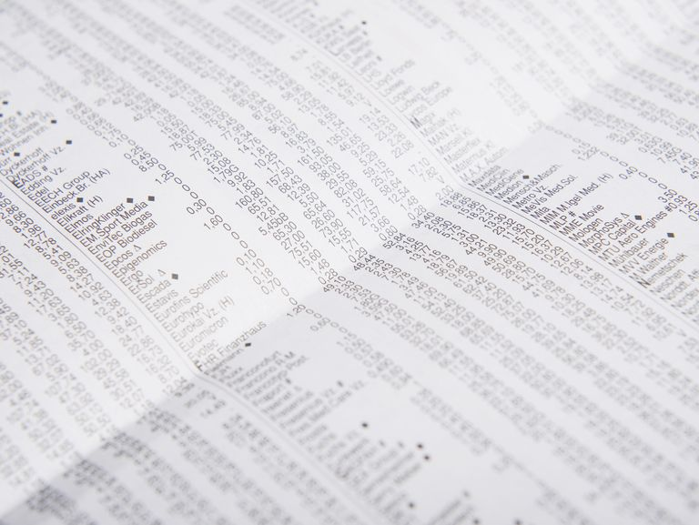 Stock exchange newspaper with market prices, close up