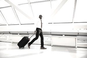 Man with luggage walking through airport