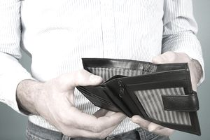 Man holding empty wallet