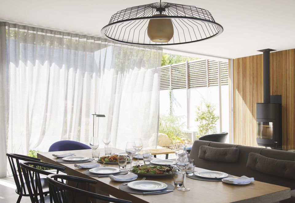 Add softness to the dining room with curtains drapes chandelier over dining table in modern dining room aloadofball Image collections