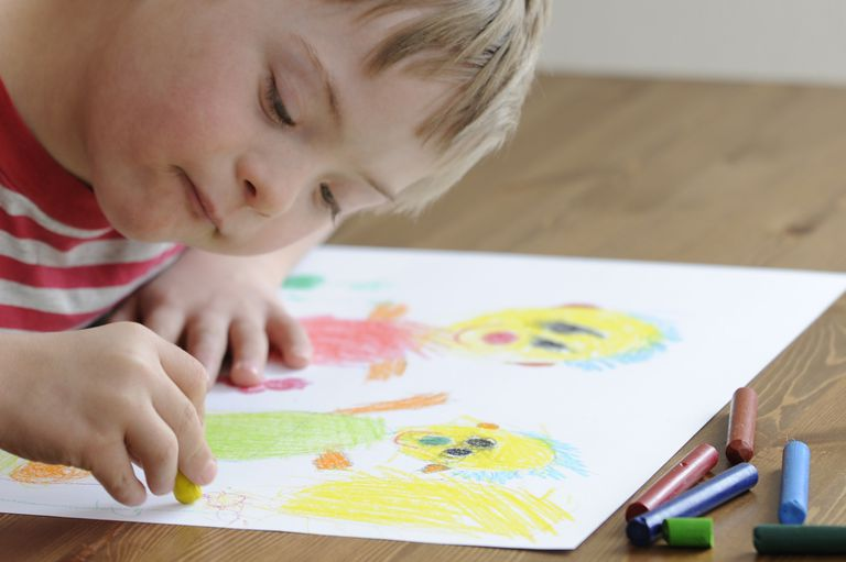 Boy with Down Syndrome is drawing