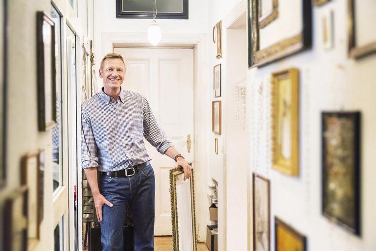 Art Collector in Apartment Corridor