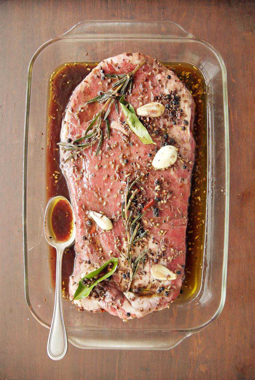 Flank Steak Marinating in a Glass Dish