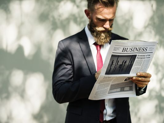 A businessman reading a paper