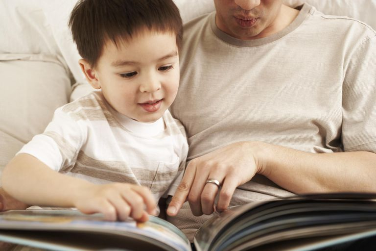 Father reading to son.
