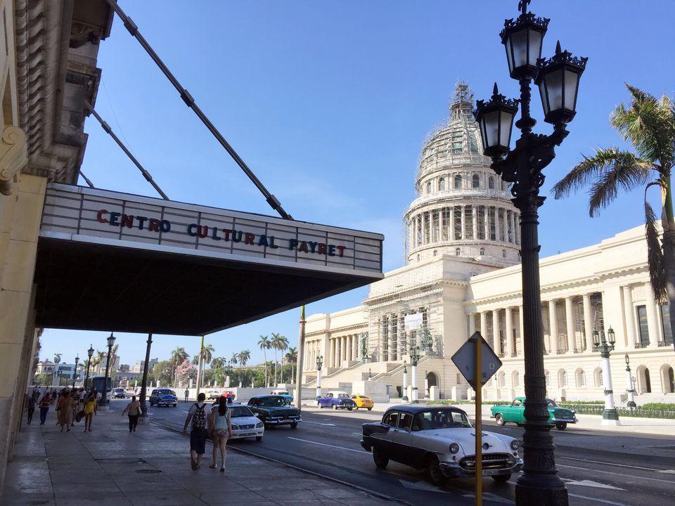 Havana street scene-El Capitolio, old theater, and classic cars