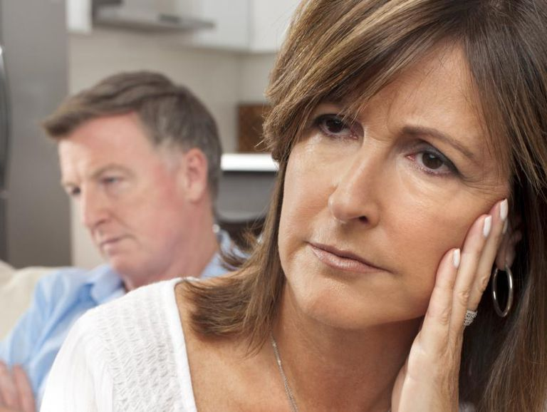 Concerned Woman With Husband