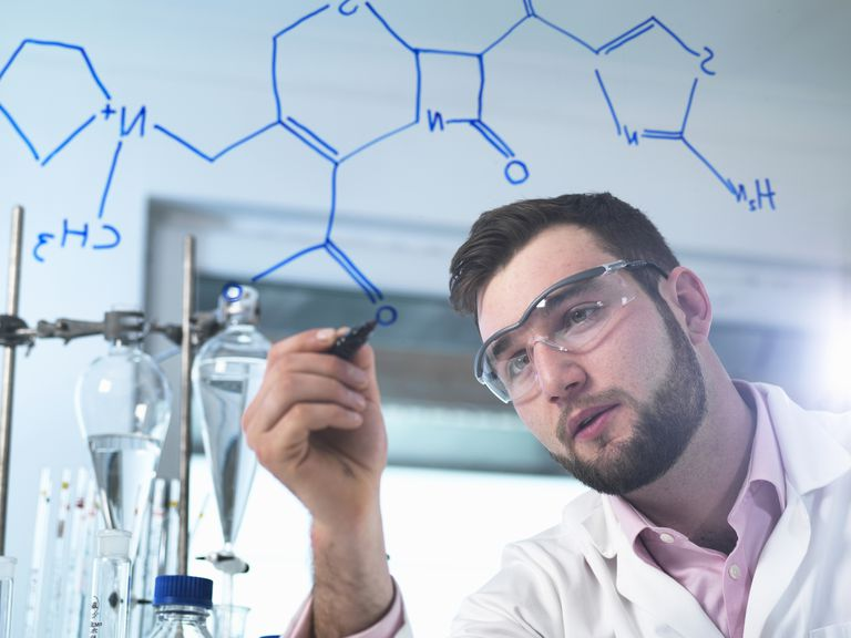Scientist illustrating antibiotic chemical formula in laboratory for pharmaceutical research ''