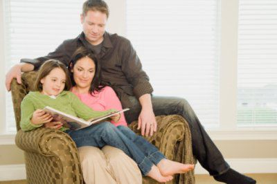 A picture of a family reading books