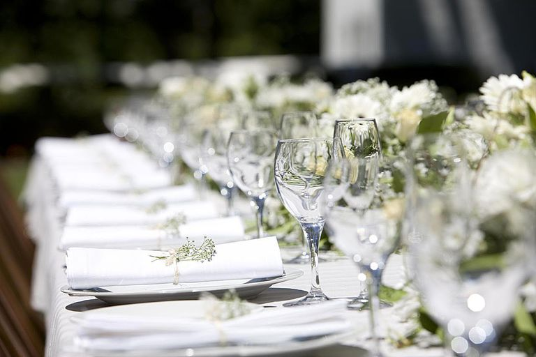 Row of place settings on table for a wedding reception