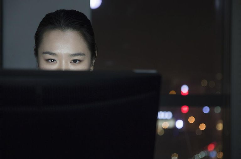 Chinese businesswoman working late in office
