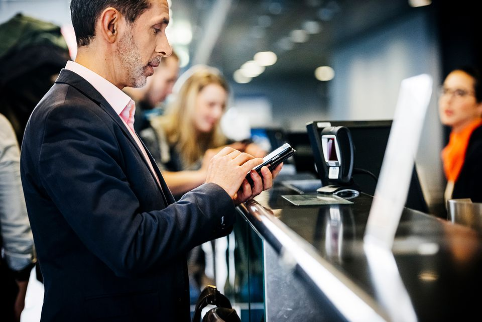 Businessman checking-In using mobile boarding pass.
