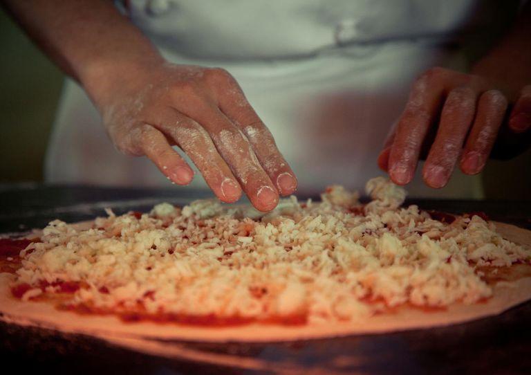 person making pizza