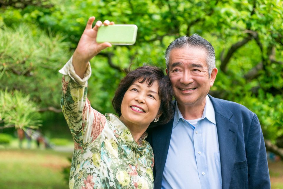 Japanese senior couple taking a selfie
