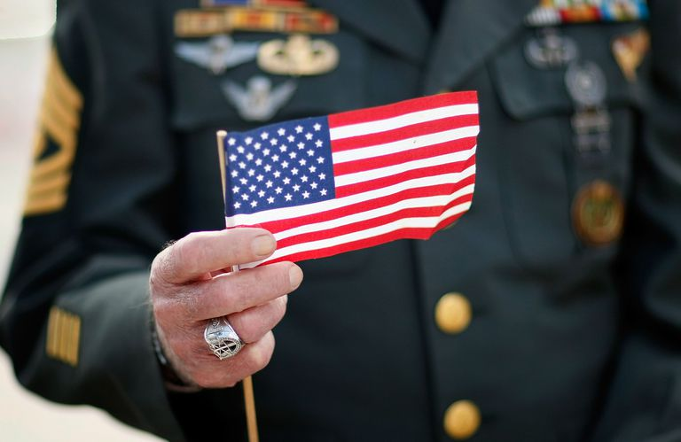 Veteran holding small American flag