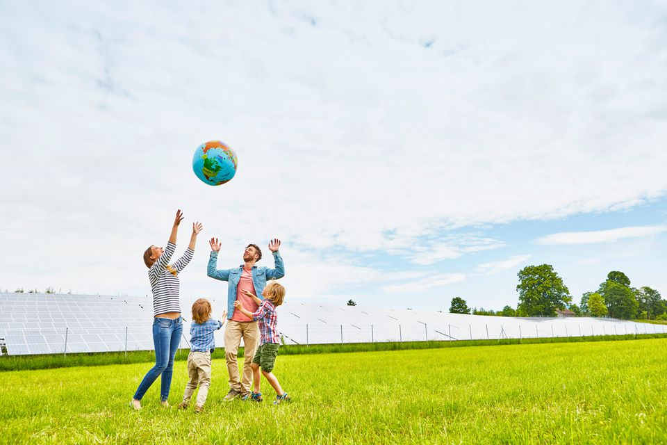 Family Playing Near Solar Farm on Earth Day