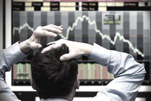Man starting at stock market graph.