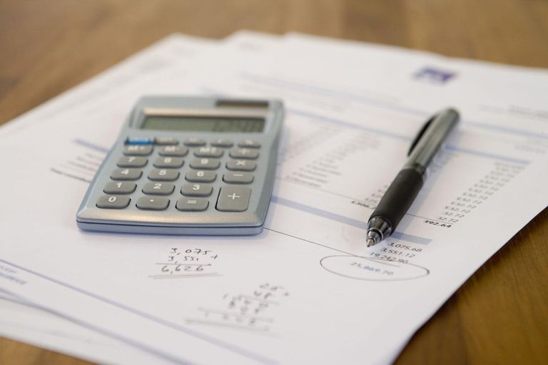 Documents, Pen and calculator on table, close-up (differential focus)