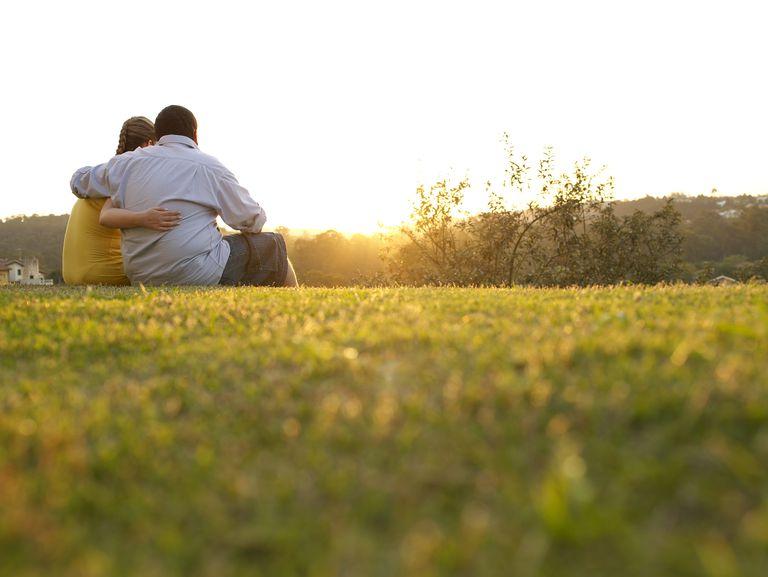 Hugged couple at the sunshine