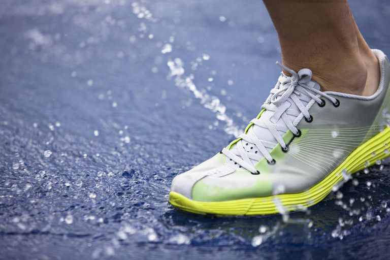 running shoe splashing water