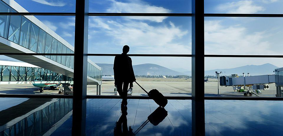 Person with suitcase at airport