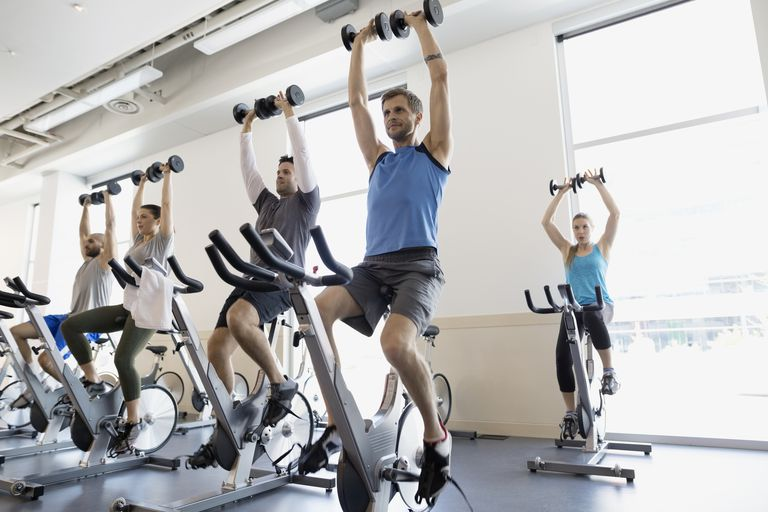 group strength workout on spin bikes