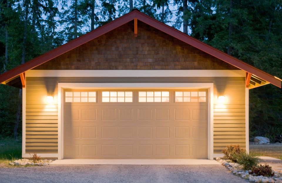 Exterior of residential garage at dusk