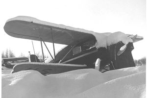 1247px-Small_airplane_buried_in_snow.jpg