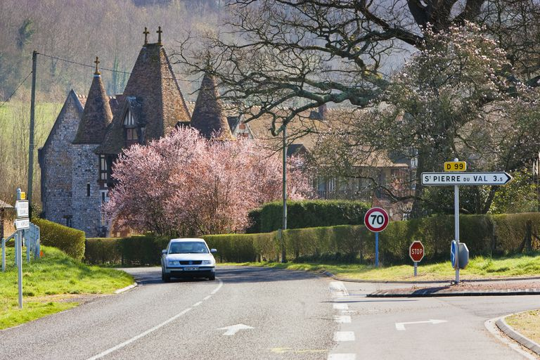 Country road to a chateau in Pays D'Auge, Calvados, Normandy, France in the Springtime