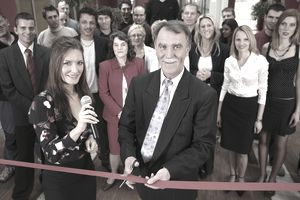 Ribbon cutting ceremony with media