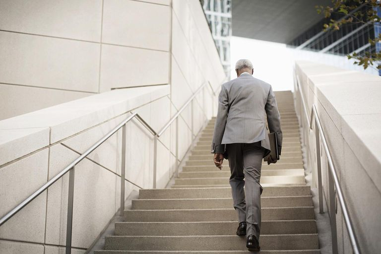 businessman ascending steps