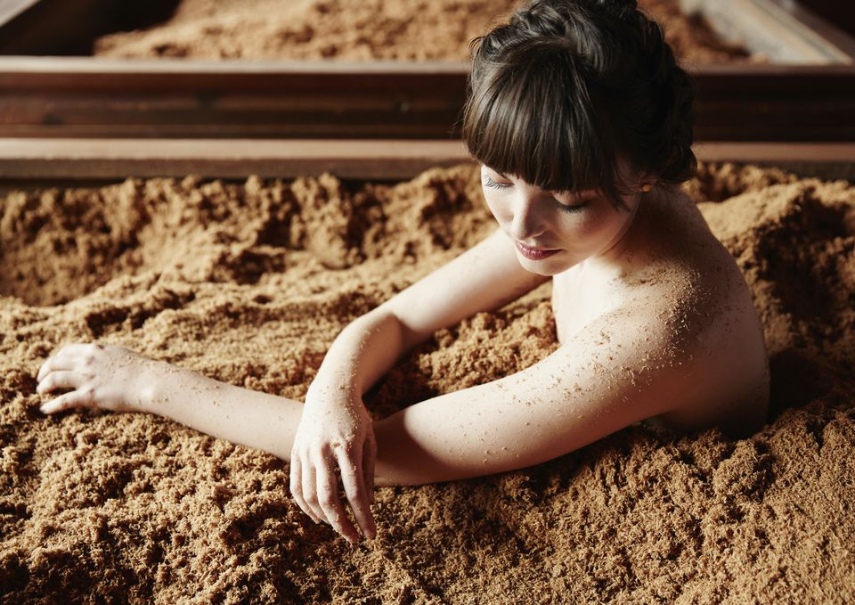 woman in mud bath