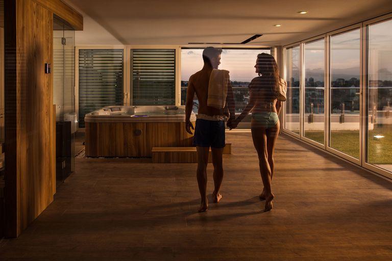 Couple walking towards hot tub